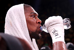 Anthony Joshua (centre) appears dejected after losing to Andy Ruiz Jr in the WBA, IBF, WBO and IBO Heavyweight World Championship match at Madison Square Garden, New York.