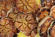 Grilled halved garlic (Allium sativum) bulbs