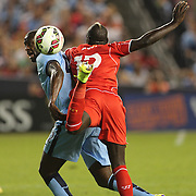 Mamadou Sakho, Liverpool, challenges Yaya Touré, Manchester City, during the Manchester City Vs Liverpool FC Guinness International Champions Cup match at Yankee Stadium, The Bronx, New York, USA. 30th July 2014. Photo Tim Clayton
