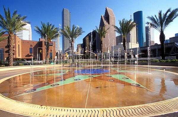 Stock photo of The Downtown Aquarium fountain and the downtown Houston skyline.