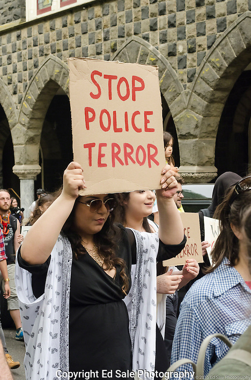 Demonstrator in 2015 May Day rally and march in Portland, Oregon holds a sign saying Stop Police Terror