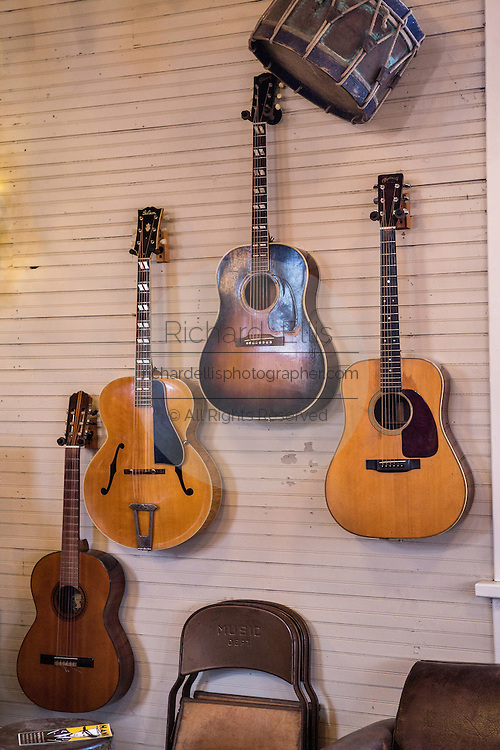 Old guitars on display at Serenite Maison antique store in Leipers Fork, Tennessee.