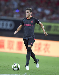 SHANGHAI, July 19, 2017  Mesut Ozil of Arsenal controls the ball during the match between Arsenal and Bayern Munich of 2017 International Champions Cup China in Shanghai, China, July 19, 2017. (Credit Image: © Jia Yuchen/Xinhua via ZUMA Wire)