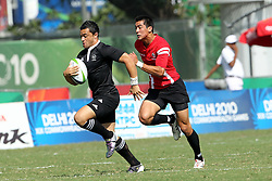 Sherwin Stowers of New Zealand during the XIX Commonwealth Games 7s rugby match between New Zealand and Canada held at The Delhi University in New Delhi, India on the  10 October 2010..Photo by:  Ron Gaunt/photosport.co.nz