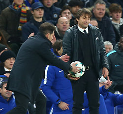 December 5, 2017 - London, England, United Kingdom - Diego Simeone manager of Atletico Madrid takes the ball from Chelsea manager Antonio Conte ..during the Champions  League Group C  match between Chelsea and Atlético Madrid at Stamford Bridge, London, England on 5 Dec   2017. (Credit Image: © Kieran Galvin/NurPhoto via ZUMA Press)