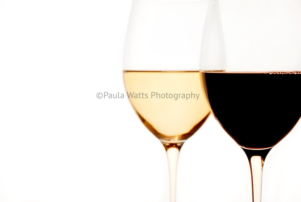 Red and White Wine in Glasses against white background