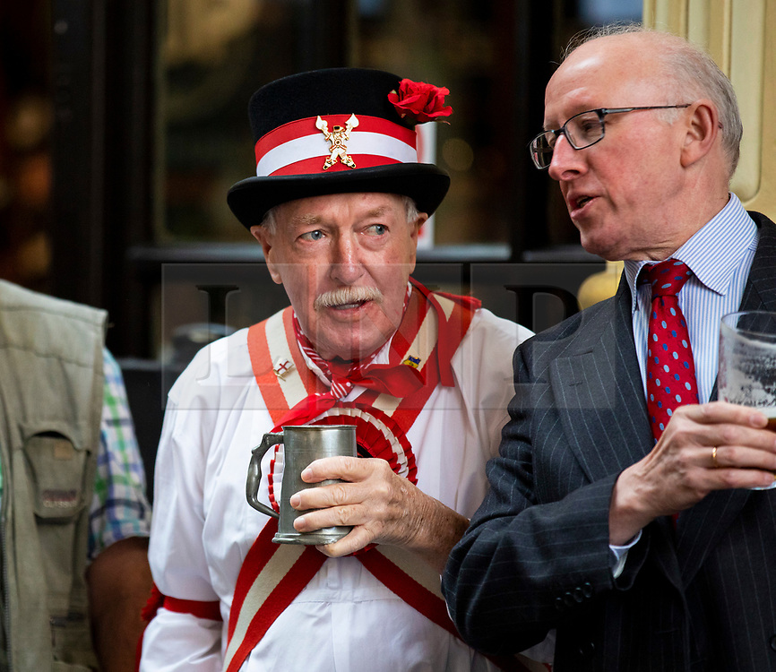© Licensed to London News Pictures. 23/04/2018. London, UK. A member of the Ewell St Mary's Morris Men enjoys a pint of ale at a St George's Day celebration in Leadenhall Market. Photo credit: Rob Pinney/LNP