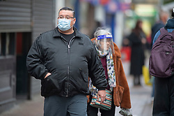 © Licensed to London News Pictures. 19/12/2020. <br /> Dartford, UK. Christmas shoppers in Dartford, Kent this morning on the last shopping weekend before Christmas. People wearing masks and social distancing to protect themselves against the threat of the new Coronavirus mutant strain which could see more restrictions imposed in the county. Photo credit:Grant Falvey/LNP