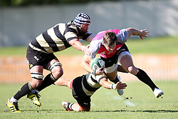 Tyler Fisher of the Pumas attempts to get past Hanno Kitshoff of Boland and Adriaan Carelse of Boland tackle during the Currie Cup premier division match between the Boland Cavaliers and The Pumas held at Boland Stadium, Wellington, South Africa on the 2nd September 2016<br /> <br /> Photo by:   Shaun Roy/ Real Time Images