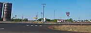 railroad grade crossing with grain elevators in rural west Texas