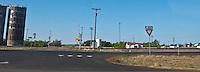 railroad grade crossing with grain elevators in rural west Texas