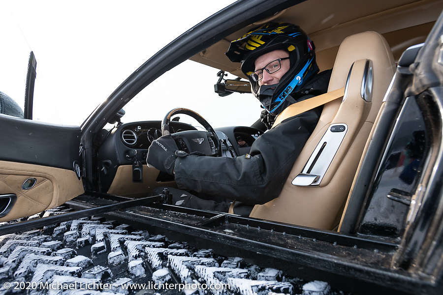 Academeg (Konstantin Zarucki), a YouTuber with 4.3 million subscribers in his Bentley Continental Ultratank, a Continental (new Continentals start at $202,000!) that he modified with winter tracks for the Baikal Mile Ice Speed Festival. Maksimiha, Siberia, Russia. Thursday, February 27, 2020. Photography ©2020 Michael Lichter.