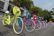 Brightly coloured Dutch bicycles with lacy hats at Fatahillah Square in Jakarta on the 1st November 2019 in Java in Indonesia.