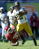 January 1, 2008 - Dallas, TX...Running back Tony Temple #22 of the Missouri Tigers rushes past free safety Kevin Woods #3 of the Arkansas Razorbacks in the fourth quarter, during the 72nd AT&T Cotton Bowl Classic at the Cotton Bowl in Dallas, Texas on January 1, 2008...The Tigers defeated the Razorbacks 38-7.  .Peter G. Aiken/CSM.