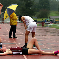 Santa Cruz High School distance runner Mari Friedman collapses onto the track after winning the girls race in a combined boys and girls 1600 meter contest during a dual meet between Santa Cruz and host San Lorenzo Valley in Felton, California on March 15, 2018.<br /> Photo by Shmuel Thaler <br /> shmuel_thaler@yahoo.com www.shmuelthaler.com