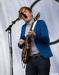 © Licensed to London News Pictures. 27/08/2011. Reading, UK. Two Door Cinema Club play the main stage on Day two of Reading Festival 2011 in Reading, Berkshire today (27/08/2011). Pictured is Alex Trimble (vocals and guitar) Photo credit: Ben Cawthra/LNP