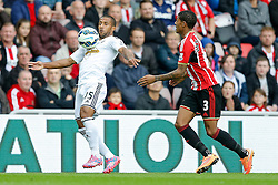 Wayne Routledge of Swansea City is challenged by Patrick van Aanholt of Sunderland - Photo mandatory by-line: Rogan Thomson/JMP - 07966 386802 - 27/08/2014 - SPORT - FOOTBALL - Sunderland, England - Stadium of Light - Sunderland v Swansea City - Barclays Premier League.
