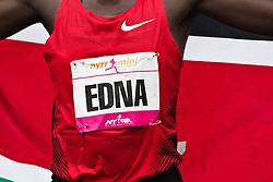NYRR Mini 10K road race (40th year); Edna Kiplagat, Kenya, with flag