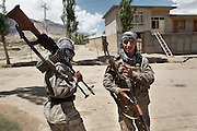 Soldiers from Afghanistan Army, doing border patrol. In the border town of Ishkashim, on the Tajikistan - Afghanistan border. Hindukush mountains.
