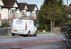 © Licensed to London News Pictures. 09/02/2019. Cheam, UK. A workman's van sits next to the crime scene surrounded by cordon tape on the London Road in North Cheam, where a woman in her 30's was stabbed to death last night. Two men have been arrested. Photo credit: Peter Macdiarmid/LNP