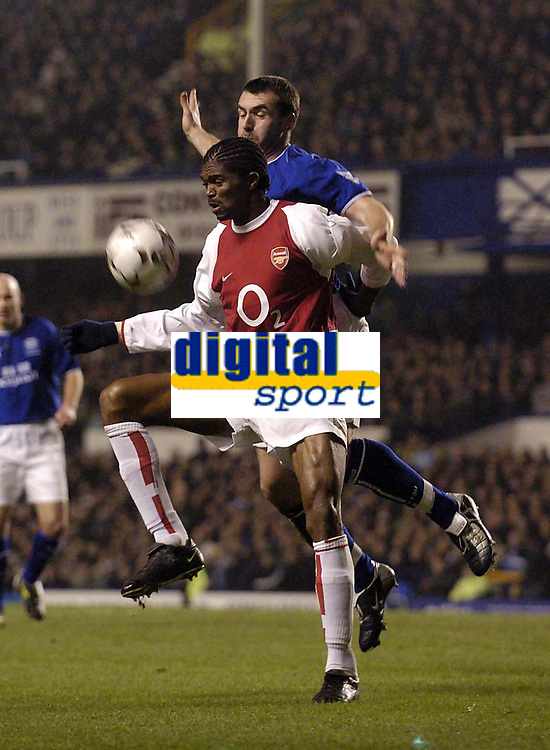 Photo. Jed Wee.<br /> Everton v Arsenal, FA Barclaycard Premiership, Goodison Park, Liverpool. 07/01/2004.<br /> Arsenal goalscorer Nwankwo Kanu shields the ball from Everton's David Unsworth.
