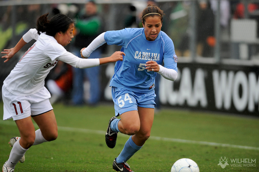 06 DEC 2009:  Casey Nogueira (54) of the University of North Carolina dribbles past Rachel Quon (11) of Stanford University during the Division I Women's Soccer Championship held at Aggie Soccer Stadium on the Texas A&M University campus in College Station, TX.  North Carolina defeated Stanford 1-0 for the national title.  © Brett Wilhelm