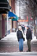 A cold, wintry conversation on a Missoula street corner. Missoula Photographer, Picture of Missoula