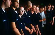 US Navy personnel line-up for a below-deck briefing on the  aircraft carrier USS Harry S Truman. Launched on 7 September 1996 and costing US$4.5 billion, the Truman (CVN-75) is the eighth Nimitz-class supercarrier of the United States Navy, named after the 33rd President of the United States, Harry S. Truman. The Truman is the largest of the US Navy's fleet of new generation carriers, a 97,000 ton floating city with a crew of 5,137, 650 are women.