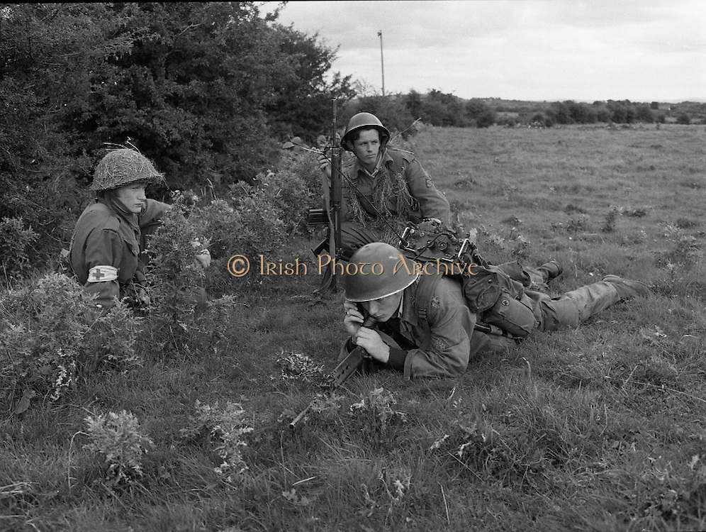"""Army Exercises In Co Sligo.   (L37).<br /> 1977.<br /> 05.09.1977.<br /> 09.05.1977.<br /> 5th September 1977.<br /> The Army Reserve Brigade, which is made up of regular units from the Southern Command, are conducting a series of conventional military exercises in counties Mayo and Sligo from the 5th to the 9th September. Approximately 1,500 men and 250 vehicles are involved. The exercise was codenamed """"Humbert"""" after an ill fated expedition by French troops into Ireland on 23rd August 1798. 1,100 French troops with Irish support took on the incumbent English forces. After some initial success they were defeated at Ballinamuk on 8th Sept 1798 by the army of Cornwallis.<br /> <br /> Pictured getting orders are Medic, James Daly Pte Thomas O'Rourke and Pte William Burke."""