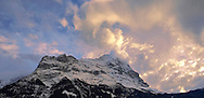 Sunset and clouds over the sumit of the North Face of the Eiger .<br /> <br /> Visit our SWITZERLAND  & ALPS PHOTO COLLECTIONS for more  photos  to browse of  download or buy as prints https://funkystock.photoshelter.com/gallery-collection/Pictures-Images-of-Switzerland-Photos-of-Swiss-Alps-Landmark-Sites/C0000DPgRJMSrQ3U