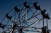 Ferris wheel silhouetted against a deep blue sky at twilight, Blue Hill Fair, Maine.