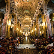 Wide-angle shot of the nave in the Metropolitan Cathedral of Santiago (Catedral Metropolitana de Santiago) in the heart of Santiago, Chile, facing Plaza de Armas. The original cathedral was constructed during the period 1748 to 1800 (with subsequent alterations) of a neoclassical design.