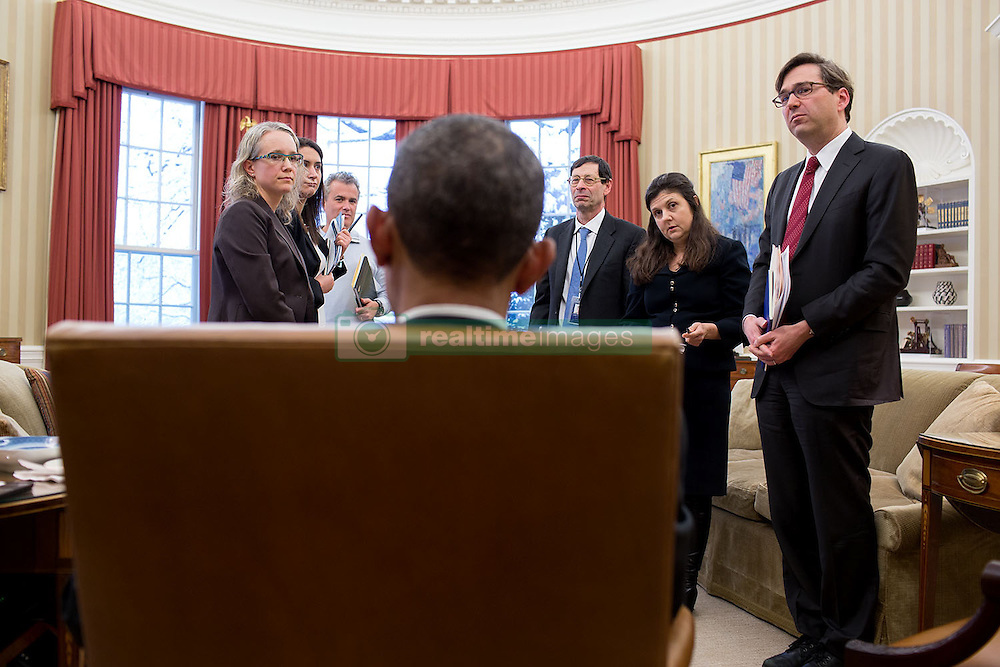 President Barack Obama talks with participants following a Council of Economic Advisers meeting in the Oval Office, March 5, 2015. Standing from left are: Abigail Wozniak, CEA Senior Economist; Jessica Schumer, CEA Chief of Staff and General Counsel; National Economic Council Director Jeffrey Zients; CEA Member Maurice Obstfeld; CEA Member Betsey Stevenson and CEA Chair Jason Furman. (Official White House Photo by Pete Souza)<br /> <br /> This official White House photograph is being made available only for publication by news organizations and/or for personal use printing by the subject(s) of the photograph. The photograph may not be manipulated in any way and may not be used in commercial or political materials, advertisements, emails, products, promotions that in any way suggests approval or endorsement of the President, the First Family, or the White House.