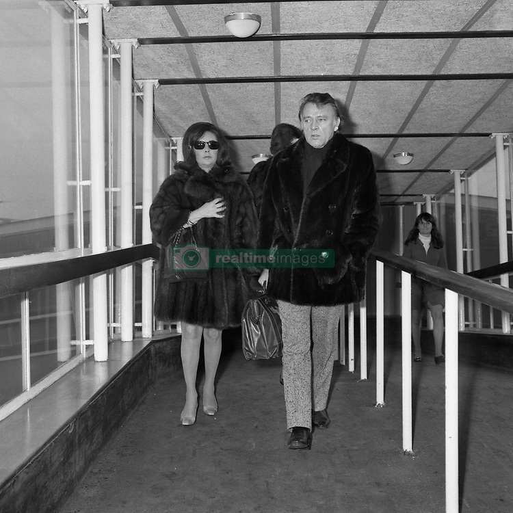 Mink-clad film stars, Elizabeth Taylor and husband Richard Burton, arrive at Heathrow Airport. They flew aboard a private executive jet plane and are in London to attend tonight's Gala Premiere of Richard Burton's latest film, 'Where Eagles Dare', to be shown in the presence of Princess Alexandra a the Empire Theatre. The premiere aids The Richard Burton Haemophilia Appeal Fund.