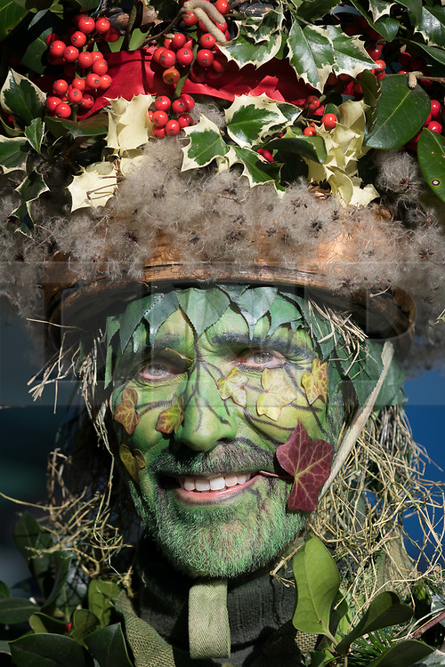 © Licensed to London News Pictures. 07/01/2018. London, UK. The Holly Man, the winter guise of the Green Man joins actors from The Bankside Mummers group (the Lions part) to take part in a procession and play near the Globe Theatre in central London, in celebration of Twelfth Night, marking the end of the twelve days of winter festivities. Twelfth Night celebrations in the traditional agricultural calendar mark a last chance to make merry before returning to the rigours of work on Plough Monday. Photo credit: Vickie Flores/LNP
