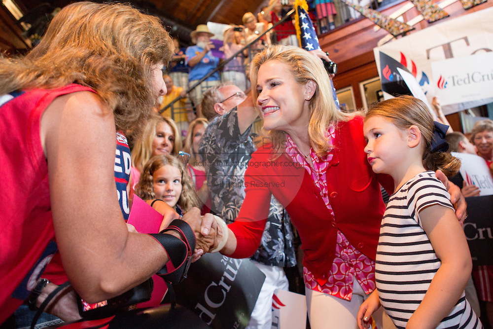 Heidi Cruz and daughter, Catherine, 4, greet supporters during a campaign event with husband U.S. Senator and GOP presidential candidate Ted Cruz at the Liberty Tap Room restaurant August 7, 2015 in Mt Pleasant, South Carolina. Cruz began a seven-day bus tour called the Cruz Country Bus Tour of southern states following the event.