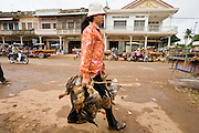 03 JULY 2006 - KOKY, CAMBODIA: A woman carries live chickens to the market in Koky, Cambodia. Photo by Jack Kurtz / ZUMA Press