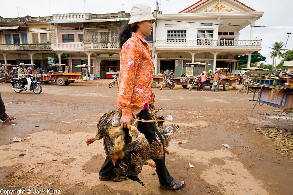 03 JULY 2006 - KOKY, CAMBODIA: A woman carries live chickens to the market in Koky, Cambodia. Photo by Jack Kurtz / ZUMA Press