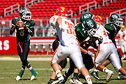 Manteca quarterback Dakarai Charles (8) looks for an open receiver against Oakdale during Friday Night Lights at Levi's Stadium in Santa Clara, California, on October 11, 2014. (Stan Olszewski/ Special to The Record)
