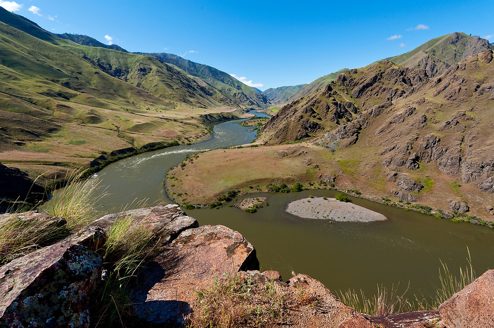 Up River view south facing of the Snake River in Hells Canyon from a trail on Idaho side at an over look called Suicide Jump. Licensing and Open Edition Prints.