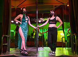 © Licensed to London News Pictures; 07/03/2021; Bristol, UK. Dancers AMELIE (left) and CHLOE (right) pictured at Urban Tiger. Bristol's two strip clubs, Central Chambers and Urban Tiger, are under threat of closure as Bristol City Council's Licensing Committee meets on Monday 08 March to decide whether to go for a nil cap for sexual entertainment venues in the city. At least 100 jobs with mainly female workers depend on the two clubs which offer stage shows, pole dancing and lap dances. There have been no breaches of the club's licences or evidence of a rise in crime near the clubs. Public consultations showed the majority of respondents were happy for SEVs to operate in Bristol. Bristol Mayor Marvin Rees, Police and Crime Commissioner Sue Mountstevens, Bristol West MP Thangam Debbonaire and some womens' groups in Bristol oppose the licence renewals, but some councillors and other groups in the city including burlesque performers and LGBTQ+ campaigners support the clubs to continue, amid debates over the dancers rights to work, equality, feminism, objectifying women and sex related violence. The female owned clubs say the council wants to close a legal business in the middle of the Coronavirus pandemic for moralistic reasons in the name of feminism, while male strippers are not subject to the same regulation. Campaigners for the clubs say that banning strip clubs discriminates against women performers and LGBTQ+ customers and will drive the industry underground with no regulation and threaten the safety of women performers. Photo credit: Simon Chapman/LNP.