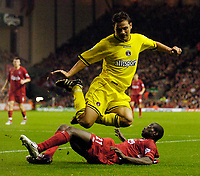 Photo. Jed Wee. Digitalsport<br /> Liverpool v Charlton Athletic, Barclays Premiership, 23/10/2004.<br /> Charlton's Luke Young takes evasive action from a tackle from Liverpool's Djimi Traore.
