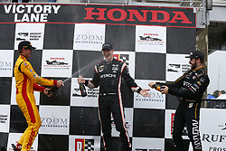 April 23, 2018 - Birmingham, Alabama, United States of America - JOSEF NEWGARDEN (1) of the United States gets sprayed in victory lane with champaign by RYAN HUNTER-REAY (28) of the United States and JAMES HINCHCLIFFE (5) of Canada after taking the checkered flag and winning the Honda Grand Prix of Alabama at Barber Motorsports Park in Birmingham, Alabama. (Credit Image: © Justin R. Noe Asp Inc/ASP via ZUMA Wire)