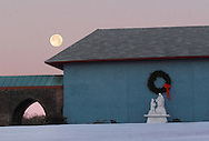 Middletown, NY  - The full moon shines above the Saint Simon Stock Scapular Vision Shrine on the morning of Dec. 24, 2007. The shrine is located at the National Shrine of Our Lady of Mount Carmel.