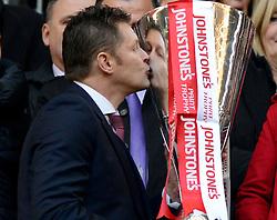 Bristol City manager, Steve Cotterill kisses the JPT Trophy  - Photo mandatory by-line: Joe Meredith/JMP - Mobile: 07966 386802 - 22/03/2015 - SPORT - Football - London - Wembley Stadium - Bristol City v Walsall - Johnstone Paint Trophy Final