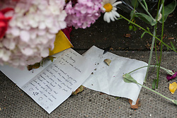 © licensed to London News Pictures. London, UK 07/07/2012. 7/7 victims being remembered as people leave flowers and letters to the memorial in Tavistock Square on attack's 7th anniversary. Fifty-two people, as well as the four bombers, were killed in the London bombing attacks, and over 700 more were injured. Photo credit: Tolga Akmen/LNP