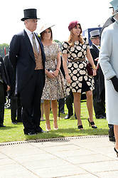 Left to right, HRH The DUKE OF YORK, HRH PRINCESS EUGENIE and HRH PRINCESS BEATRICE at the Investec Derby 2013 held at Epsom Racecourse, Epsom, Surrey on 1st June 2013.