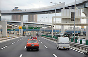 highway with traffic and residential high rise around Tokyo Japan