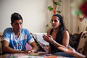 Paralegal Romina Kajtazova visiting the Ridarov family during door to door activity in the Roma community of Crnik. Asan Ridarov (left) had problems - because of being Roma - leaving Macedonia for  Germany (passport issue) and is discussing that with Romina.