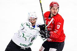 Andraz Zibelnik of HK SZ Olimpija vs Jaka Sturm of HDD SIJ Acroni Jesenice during ice hockey match between HDD SIJ Acroni Jesenice and HK SZ Olimpija in fourth game of Final at Slovenian National League, on May 7, 2021 in Podmezaklja, Jesenice, Slovenia. Photo by Matic Klansek Velej / Sportida